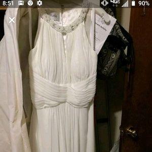 A wedding dress that was never worn.